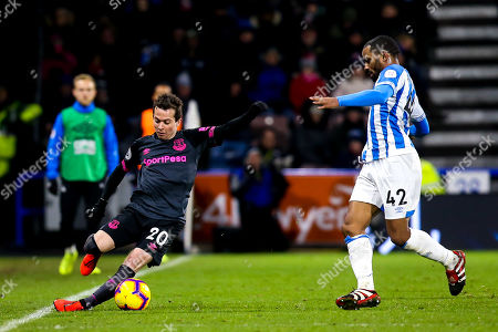 Bernard of Everton slips as he takes on Jason Puncheon of Huddersfield Town