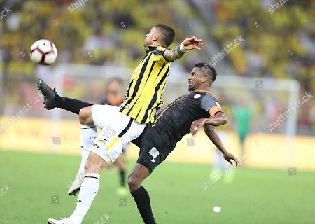 Al-Ittihad player Manuel Marouan Da Costa (L) in action for the ball with Al-Shabab player Naser Al-Shamrani (R) during the Saudi Professional League soccer match between Al-Ittihad and Al-Shabab at King Abdullah International Stadium AlJawhra, Jeddah, Saudi Arabia, 29 January 2019.