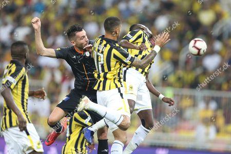 Al-Shabab player Valerica Gaman  (L) in action for the ball with Al-Ittihad player Manuel Marouan Da Costa(R) during the Saudi Professional League soccer match between Al-Ittihad and Al-Shabab at King Abdullah International Stadium AlJawhra, Jeddah, Saudi Arabia, 29 January 2019.