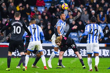 Mathias Zanka Jorgensen of Huddersfield Town (25) holds off Tom Davies of Everton (26) for the header during the Premier League match between Huddersfield Town and Everton at the John Smiths Stadium, Huddersfield