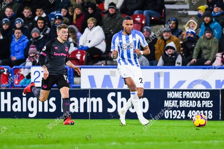 Lucas Digne of Everton (12) chases down Mathias Zanka Jorgensen of Huddersfield Town (25) during the Premier League match between Huddersfield Town and Everton at the John Smiths Stadium, Huddersfield