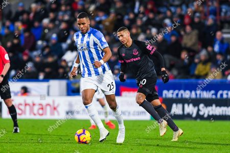 Mathias Zanka Jorgensen of Huddersfield Town (25) in action  with Richarlison of Everton (30) nearby during the Premier League match between Huddersfield Town and Everton at the John Smiths Stadium, Huddersfield