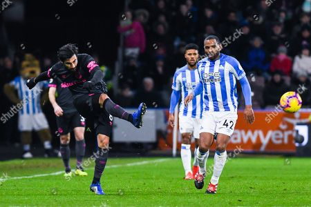 André Gomes of Everton (8) passes the ball with Jason Puncheon of Huddersfield Town (42) nearby during the Premier League match between Huddersfield Town and Everton at the John Smiths Stadium, Huddersfield