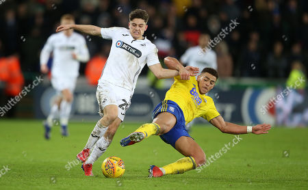 Daniel James of Swansea City is tackled by Che Adams of Birmingham City.