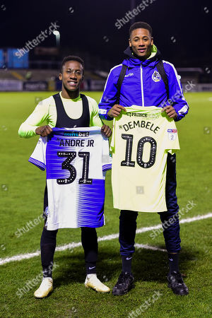 Alexis Andre Jr of Bristol Rovers with Siriki Dembele of Peterborough United after the final whistle of the match
