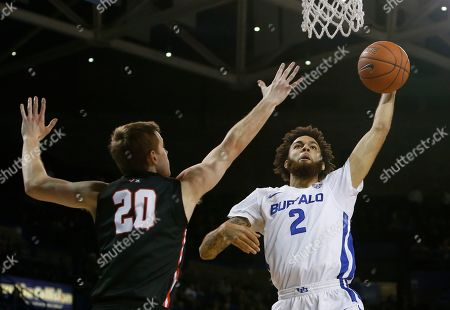 Buffalo guard Jeremy Harris (2) drives to the basket against Ball State guard Austin Nehls (20) during the second half of an NCAA college basketball game, in Buffalo, N.Y