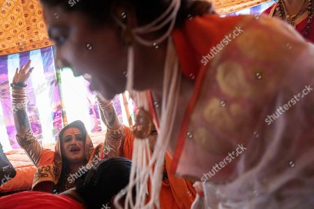 """Laxmi Narayan Tripathi, an Indian transgender activist and leader of the """"Kinnar akhara"""" monastic order, celebrates the invitation by the """"Juna Akhad""""' to take part in the Kumbh's first royal bath, a sadhu-led procession into the river on Jan. 15, during the Kumbh Mela festival in Prayagraj, India. Kinnars celebrated their inclusion at Kumbh as a victory, but their greater acceptance by Hinduism's most powerful leaders, in the religious and political spheres, remains to be seen. Unlike other akharas, which are only open to Hindu men, Kinnar, founded in 2015, is open to all genders and religions"""