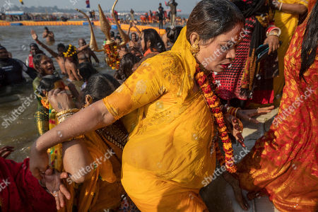 "Members of the newly formed ""'Kinnar akhara"" take a dip on the auspicious Makar Sankranti day during the Kumbh Mela festival in Prayagraj, Uttar Pradesh state, India. This is the first time the newly formed monastic order, led by transgender activist Laxmi Narayan Tripathi, has set up camp at the massive temporary city in Prayagraj. Unlike other akharas, which are only open to Hindu men, Kinnar, founded in 2015, is open to all genders and religions"