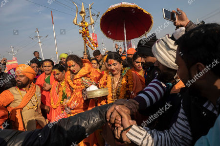 "Laxmi Narayan Tripathi, center left, a transgender activist and founder of the ""Kinnar Akhara"" monastic order arrive with other members of the order for a spiritual-cleansing dip on the auspicious Makar Sankranti day during the Kumbh Mela festival in Prayagraj, Uttar Pradesh state, India. Kinnars celebrated their inclusion at Kumbh as a victory, but their greater acceptance by Hinduism's most powerful leaders, in the religious and political spheres, remains to be seen. Unlike other akharas, which are only open to Hindu men, Kinnar, founded in 2015, is open to all genders and religions"