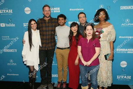 "Demi Moore, Patrick Brice, Karan Soni, Jennifer Kim, Ed Helms, Martha Kelly, and Jessica Williams. From left to right, Demi Moore, filmmaker Patrick Brice, Karan Soni, Jennifer Kim, Ed Helms, Martha Kelly, and Jessica Williams pose at the premiere of the film ""Corporate Animals"" during the 2019 Sundance Film Festival, in Park City, Utah"
