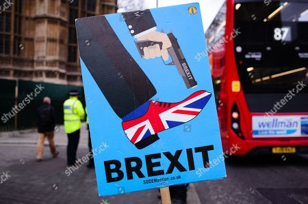 An anti-Brexit placard stands outside the Houses of Parliament in central London. In the Commons, on a day of significant parliamentary activity over Brexit, MPs voted down a cross-party amendment tabled by Labour Party MP Yvette Cooper and Conservative Party MP Nick Boles designed to substantially reduce the risk of a much-feared 'no-deal' exit from the EU. An amendment rejecting the principle of a no-deal exit was meanwhile approved, as was a government-backed amendment championed by Conservative Party MP Graham Brady calling for 'alternative arrangements' to take the place of the controversial Irish 'backstop' provision in the withdrawal agreement negotiated with the EU.