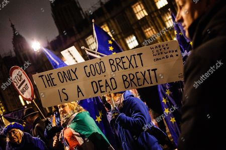 Stock Photo of Opponents of Brexit demonstrate outside the Houses of Parliament in central London. In the Commons, on a day of significant parliamentary activity over Brexit, MPs voted down a cross-party amendment tabled by Labour Party MP Yvette Cooper and Conservative Party MP Nick Boles designed to substantially reduce the risk of a much-feared 'no-deal' exit from the EU. An amendment rejecting the principle of a no-deal exit was meanwhile approved, as was a government-backed amendment championed by Conservative Party MP Graham Brady calling for 'alternative arrangements' to take the place of the controversial Irish 'backstop' provision in the withdrawal agreement negotiated with the EU.