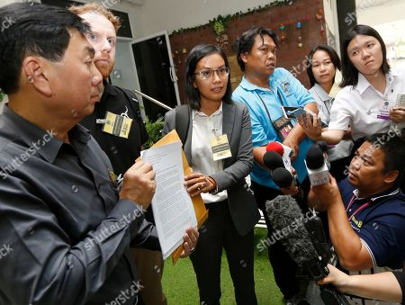 Stock Image of Thai human rights lawyer Natthasiri Bergman (3-L) and Evan Jones (2-L) of the Asia Pacific Refugee Rights Network, who are representing the family of Bahraini soccer player Hakeem Al-Araibi, deliver a letter addressed to the Thai Prime Minister to the complaint center of Government House in Bangkok, Thailand, 30 January 2019. The Thai criminal court on 11 December 2018 started an extradition hearing to decide whether or not to extradite Al-Araibi, a Bahraini soccer player with Australian refugee status, on Bahrain's request.