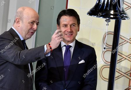 Italian premier Giuseppe Conte (R) and the managing director of Borsa Italiana Raffaele Jerusalmi at the opening ceremony of the session that traditionally indicates the beginning of the negotiations at Stock Exchange at Piazza Affari in Milan, Italy, 30 January 2019.