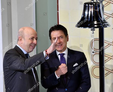 Italian premier Giuseppe Conte (R) and the managing director of Borsa Italiana Raffaele Jerusalmi at the opening ceremony of the session ringing the bell that traditionally indicates the beginning of the negotiations at Stock Exchange on Piazza Affari in Milan, Italy, 30 January 2019.
