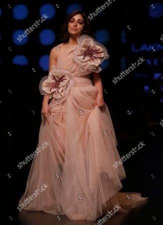 Bollywood actress Yami Gautam displays a creation by Gauri and Nainika during the Lakme Fashion Week in Mumbai, India