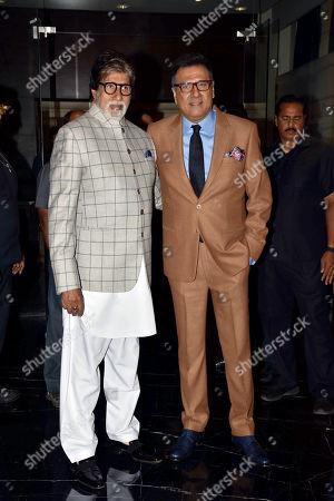 Actor Boman Irani (R) with actor Amitabh Bachchan (L)