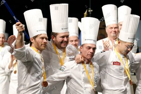 Stock Photo of First place winner Danish chef Kenneth Toft-Hansen (2-L), his commis Christian Wellendorf Kleinert (R), team coach Rasmus Kofoed (L) and team president Francis Cardenau (2-R) celebrate after competing in the final event of the Bocuse d'Or International culinary competition at the Sirha International Hotel Catering and Food trade Exhibition, in Lyon, France, 30 January 2019.