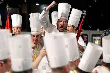 Stock Picture of First place winner Danish chef Kenneth Toft-Hansen (C), team coach Rasmus Kofoed (R) and team president Francis Cardenau (L) celebrate after competing in the final event of the Bocuse d'Or International culinary competition at the Sirha International Hotel Catering and Food trade Exhibition, in Lyon, France, 30 January 2019.