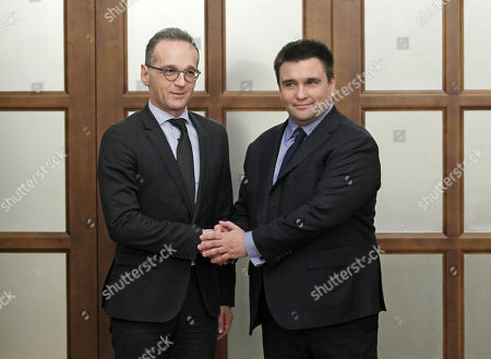 German Foreign Minister Heiko Maas (L) and Ukrainian Foreign Minister Pavlo Klimkin (R) are seen shaking hands during their meeting in Kiev.