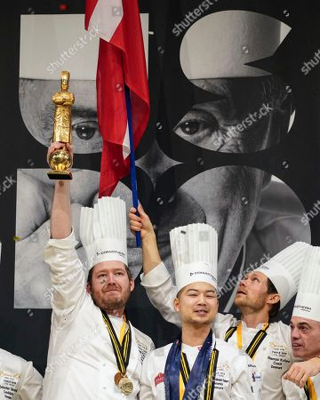 """Stock Image of Kenneth Toft-Hansen of Denmark, left, celebrates on the podium with his commis Christian Wellendorf, second left, team's coach Rasmus Kofoed, second right, and jury president Francis Cardeneau, right, after winning the final of the """"Bocuse d'Or"""" (Golden Bocuse) trophy, in Lyon, central France, . The contest, a sort of world cup of cuisine, was started in 1987 by Lyon chef Paul Bocuse to reward young international culinary talents"""