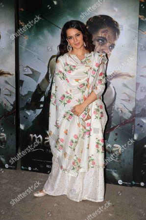 Bollywood actor Kangana Ranaut poses for photographers on her arrival at the special screening of Manikarnika