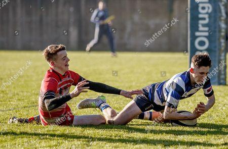 Stock Picture of Crescent College Comprehensive vs Glenstal Abbey. Cresent College's Jamie Duggan scores his sides second try despite Michael Buckley of Glenstal