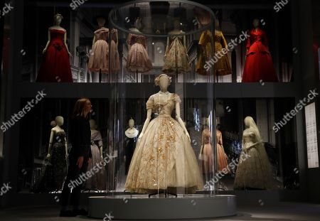 A Christian Dior Haute couture, creation 1951, evening dress of silk straw mother of pearl and sequins, designed specially for the 21st birthday of Princess Margaret, sister of Britain's Queen Elizabeth II, on display during a press preview of the largest exhibition in the United Kingdom of the Paris based fashion House of Dior at the V&A Museum in London, . Billed as the largest and most comprehensive exhibition ever staged in Britain on the revered fashion house, the exhibition traces the impact of Dior over seven decades and showcases dozens of spectacular couture gowns