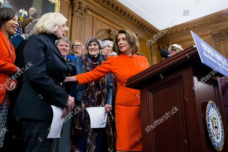 US Speaker of the House Nancy Pelosi (R) speaks beside activist Lilly Ledbetter (L), Democratic Representative from Connecticut Rosa DeLauro (Back C) and others during an event with Democratic members of Congress and national organization members to reintroduce the Paycheck Fairness Act, on Capitol Hill in Washington, DC, USA, 30 January 2019. Democratic members of Congress reintroduce the Paycheck Fairness Act ten years after former US President Barack Obama signed into law the the Lilly Ledbetter Fair Pay Act. The legislation intends to close the pay gap between men and women by requiring equal pay for equal work.