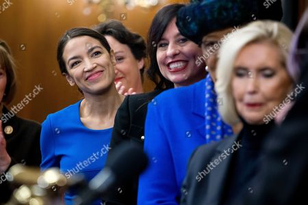 Democratic Representative from New York Alexandria Ocasio-Cortez (L) participates in an event with Democratic members of Congress and national organization members to reintroduce the Paycheck Fairness Act, on Capitol Hill in Washington, DC, USA, 30 January 2019. Democratic members of Congress reintroduce the Paycheck Fairness Act ten years after former US President Barack Obama signed into law the the Lilly Ledbetter Fair Pay Act. The legislation intends to close the pay gap between men and women by requiring equal pay for equal work.