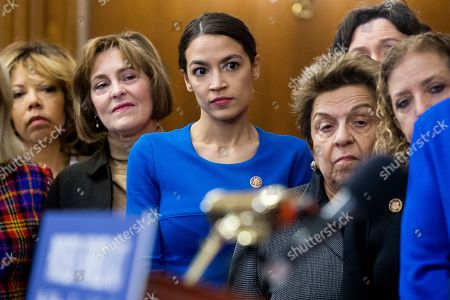 Democratic Representative from New York Alexandria Ocasio-Cortez (C) participates in an event with Democratic members of Congress and national organization members to reintroduce the Paycheck Fairness Act, on Capitol Hill in Washington, DC, USA, 30 January 2019. Democratic members of Congress reintroduce the Paycheck Fairness Act ten years after former US President Barack Obama signed into law the the Lilly Ledbetter Fair Pay Act. The legislation intends to close the pay gap between men and women by requiring equal pay for equal work.