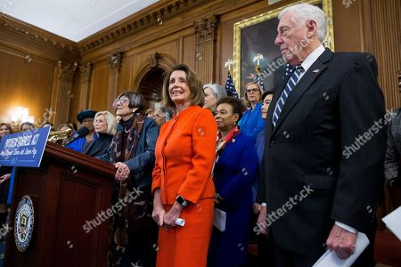 US Speaker of the House Nancy Pelosi (C) and House Majority Leader Democrat Steny Hoyer (R) listen to Democratic Representative from Connecticut Rosa DeLauro (Front L) speak at a podium during an event with Democratic members of Congress and national organization members to reintroduce the Paycheck Fairness Act, on Capitol Hill in Washington, DC, USA, 30 January 2019. Democratic members of Congress reintroduce the Paycheck Fairness Act ten years after former US President Barack Obama signed into law the the Lilly Ledbetter Fair Pay Act. The legislation intends to close the pay gap between men and women by requiring equal pay for equal work.