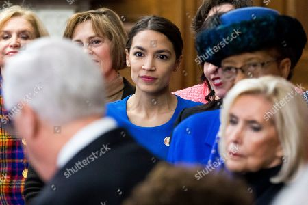 Democratic Representative from New York Alexandria Ocasio-Cortez (C) listens to House Majority Leader Democrat Steny Hoyer (Front) speak, as activist Lilly Ledbetter (R) looks on; during an event with Democratic members of Congress and national organization members to reintroduce the Paycheck Fairness Act, on Capitol Hill in Washington, DC, USA, 30 January 2019. Democratic members of Congress reintroduce the Paycheck Fairness Act ten years after former US President Barack Obama signed into law the the Lilly Ledbetter Fair Pay Act. The legislation intends to close the pay gap between men and women by requiring equal pay for equal work.