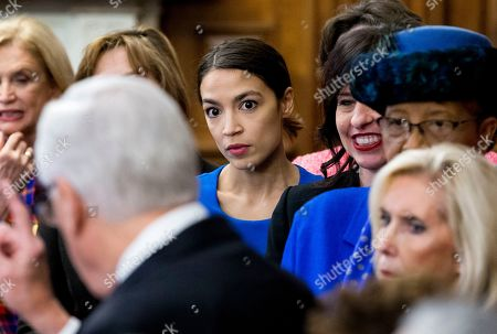 Democratic Representative from New York Alexandria Ocasio-Cortez (C) listens to House Majority Leader Democrat Steny Hoyer (Front) speak; during an event with Democratic members of Congress and national organization members to reintroduce the Paycheck Fairness Act, on Capitol Hill in Washington, DC, USA, 30 January 2019. Democratic members of Congress reintroduce the Paycheck Fairness Act ten years after former US President Barack Obama signed into law the the Lilly Ledbetter Fair Pay Act. The legislation intends to close the pay gap between men and women by requiring equal pay for equal work.