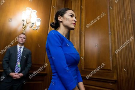 Democratic Representative from New York Alexandria Ocasio-Cortez arrives to participate in an event with Democratic members of Congress and national organization members that are reintroducing the Paycheck Fairness Act, on Capitol Hill in Washington, DC, USA, 30 January 2019. Democratic members of Congress reintroduce the Paycheck Fairness Act ten years after former US President Barack Obama signed into law the the Lilly Ledbetter Fair Pay Act. The legislation intends to close the pay gap between men and women by requiring equal pay for equal work.