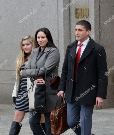 Stock Picture of Natalie Edwards, center, leaves Federal court, in New York. Edwards, a senior official at the department's Financial Crimes Enforcement Network, also known as FinCEN, is accused of leaking several confidential suspicious activity reports to a journalist