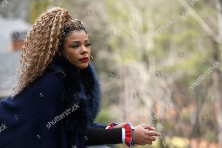 """Singer and TV personality Syleena Johnson poses for a photo at her home in Alpharetta, Ga. Johnson, who appeared in the reality series """"R&B Divas"""" and co-hosts the TV One daytime talk show, """"Sister Circle,"""" sang the 2001 song, """"I Am Your Woman,"""" which was written and produced by R. Kelly"""