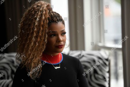 """Stock Image of Singer and TV personality Syleena Johnson poses for a photo at her home in Alpharetta, Ga. Johnson, who appeared in the reality series """"R&B Divas"""" and co-hosts the TV One daytime talk show, """"Sister Circle,"""" sang the 2001 song, """"I Am Your Woman,"""" which was written and produced by R. Kelly"""