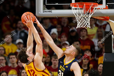 Michael Jacobson, Logan Routt. West Virginia forward Logan Routt blocks a shot by Iowa State forward Michael Jacobson, left, during the first half of an NCAA college basketball game, in Ames, Iowa