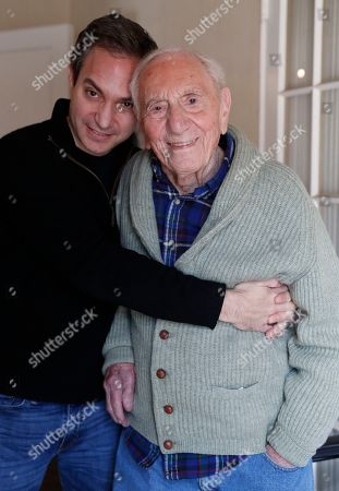 """Novelist, playright and editor A.E. Hotchner, 101, Ernest Hemingway's close friend and biographer, poses for a photograph with his son Timothy, a documentary filmmaker and editor, in Westport, Conn. When the 1958 film adaptation """"The Old Man and the Sea"""" hit theaters, Hemingway told his close friend that he hated it and urged his writer pal to do his own adaptation someday. Hotchner, now 101, has finally completed Hemingway's request, and the stage adaptation of """"The Old Man and the Sea,"""" done in collaboration with son Tim, is set to premiere in Pittsburgh on Feb. 1. The senior Hotchner also co-founded Newman's Own with Paul Newman"""