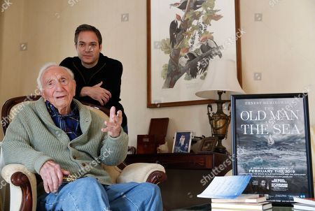 """Ernest Hemingway's close friend and biographer A.E. Hotchner, left, and his son Tim Hotchner, a documentary filmmaker and writer, chat during an interview with The Associated Press, at the family's home in Westport, Conn. When the 1958 film adaptation """"The Old Man and the Sea"""" hit theaters, Hemingway told his close friend that he hated it and urged his writer pal to do his own adaptation someday. Hotchner, now 101, has finally completed Hemingway's request, and the stage adaptation of """"The Old Man and the Sea,"""" done in collaboration with son Tim, is set to premiere in Pittsburgh on Feb. 1. Mr. Hotchner also co-founded Newman's Own with Paul Newman"""