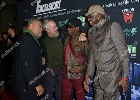 Laurence Fishburne, Titus Welliver, Wesley Snipes, Bill Duke. Laurence Fishburne, from left, Titus Welliver, Wesley Snipes and Bill Duke speak as they arrive at Excelsior! A Celebration of the Amazing, Fantastic, Incredible & Uncanny Life of Stan Lee, at the TCL Chinese Theatre in Los Angeles