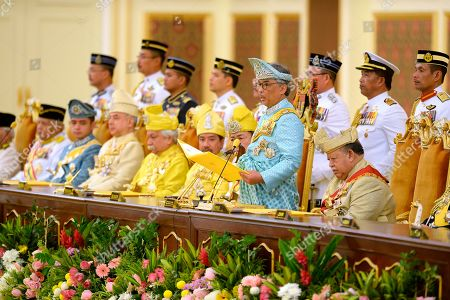Malaysia's Sultan Abdullah Sultan Ahmad Shah, second from right, takes an oath next to former king, Tuanku Syed Sirajuddin of Perlis, right, Sultan Mizan Zainal Abidin of Terengganu, fifth from left, and Sultan Sharafuddin Idris Shah, sixth from left, of Selangor State during his coronation at National Palace in Kuala Lumpur, Malaysia, . Sultan Abdullah of central Pahang state was crowned Thursday as Malaysia's 16th king under a unique rotating monarchy system, nearly a month after the sudden abdication of Sultan Muhammad V