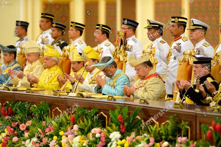 Stock Photo of Malaysia's Sultan Abdullah Sultan Ahmad Shah third from right, prays next to former king, Tuanku Syed Sirajuddin of Perlis, second from right, Sultan Mizan Zainal Abidin of Terengganu, fourth from left, and Sultan Sharafuddin Idris Shah, fifth from left, of Selangor State during his coronation at National Palace in Kuala Lumpur, Malaysia, . Sultan Abdullah of central Pahang state was crowned Thursday as Malaysia's 16th king under a unique rotating monarchy system, nearly a month after the sudden abdication of Sultan Muhammad V