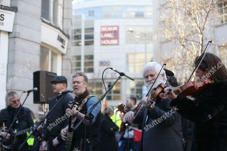 Musicians Glen Hansard (3rdL) and John Sheahan (White beard) play at the launch