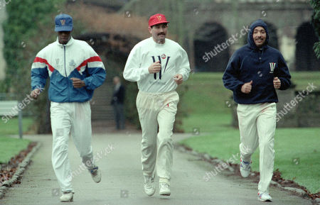 England Cricket Squad at Lilleshall National Sports Recreation Centre, Newport. Skipper Graham Gooch jogging with Chris Lewis and Phil DeFreitas [R]