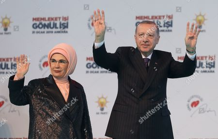 Turkish President Recep Tayyip Erdogan (R) and his wife Emine Gulbaran (R) greet their supporters during the meeting and presentation of candidates for the local elections in Ankara, Turkey, 31 January 2019. Local elections are scheduled for 31 March 2019.