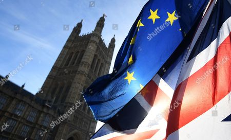 EU campaigners wave the EU and UK flags outside parliament in London, Britain, 31 January 2019. The House of Commons is set to vote on British Prime Minister Theresa May's Plan B for Brexit on 13 February.