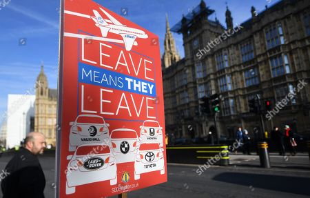 EU campaign placard warning that 'Leave' would see an exit of car industry and Airbus from the UK, outside parliament in London, Britain, 31 January 2019. The House of Commons is set to vote on British Prime Minister Theresa May's Plan B for Brexit on 13 February.