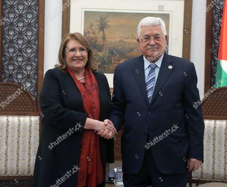 Palestinian President Mahmoud Abbas shakes hands with Malta's President Marie Louise Coleiro Preca